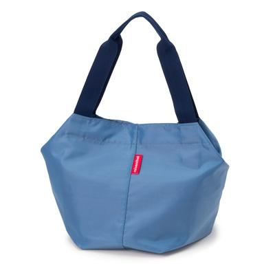 両端のトグルを外すと縦に伸びて大きく変化する、便利なトートバッグです。